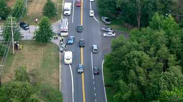 Anne Arundel County police assisted the driver in the car as other officers, including K-9 units, went to search for the SUV driver.