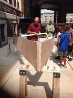 The students at the Baltimore Collegiate Summer Bridge Academy spent part of their summer building a 12 foot boat.
