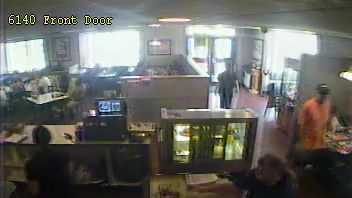 This is a surveillance photo from the Denny's Restaurant in Edgewood, where a fire was set, causing $500,000 in damages.
