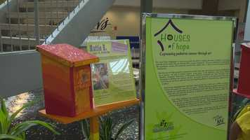 Each birdhouse on display in White Marsh Mall is accompanied by a short bio of each artist.