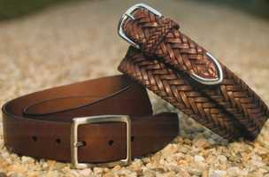 Belts with or without buckles (but not buckles by themselves)