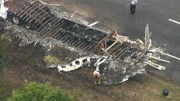 The charred remains block the eastbound lanes for most of Friday.