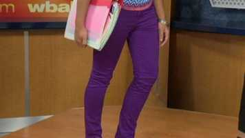 Our fashion expert says to go for deeper colors in fall like the purple jean-leggings our model is wearing.