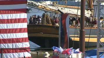 The athletes and public officials arrive at the ceremony via the Pride of Baltimore II.