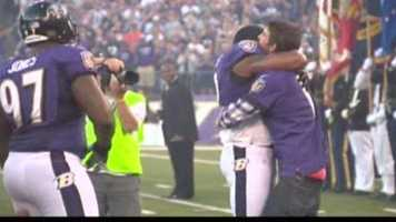 Phelps, who was an honorary captain for the game, got a huge bear hug from Ray Lewis.