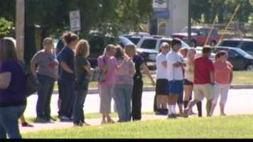 Parents rushed to the school after receiving a phone call from school administrators that a student brought a gun to Stemmers Run Middle School.