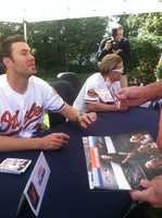 Some members of the Baltimore Orioles took time out of their busy schedule on Saturday to sign autographs and help the Baltimore Animal Rescue and Care Shelter out.