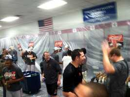 WBAL-TV 11 Sports anchor Pete Gilbert takes us into the clubhouse for the O's celebration after beating the Rangers, 5-1