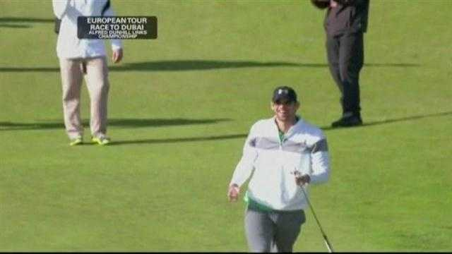 Michael Phelps celebrates after sinking a 153-foot putt at the Dunhill Championship in Scotland.