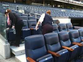Crews prepare Yankee Stadium before Game 3 of the ALDS.