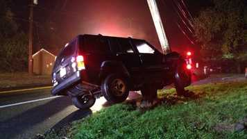 Rescuers extricate a woman from a sport utility vehicle after she crashed into a pole in Harford County.