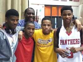 (From left to right) Bobby Mack, Leon Fleming, Jesse Barr, and Antoine Montgomery. Coach William Russell behind the young men.