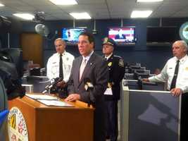 Baltimore County Executive Kevin Kamenetz (at the podium) holds a press conference about the county's preparations for potential effects of Hurricane Sandy.