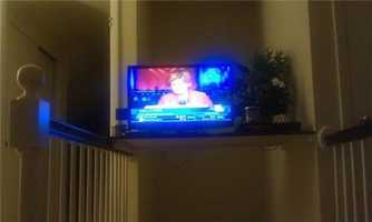 Paul Harrop tweets this photo of his television, tuned to WBAL-TV 11 while reporter Sally Kidd is live on air.