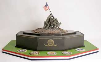 Charm City Cakes made an Iwo Jima cake for veterans. The cake is being served along with other free food vets can get Monday at MissionBarbecuein Glen Burnie.