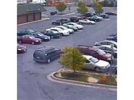 Two photos from the Walmart in Middle River location show the parking lot and a minivan. Investigators on the case of the armed abduction of Vi Ripken say they believe the occupants of the minivan may have had contact with a man of interest in the case.