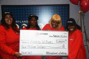 Pictured (from left to right):  Sharonda Harden (niece), Shawnice Perry (daughter), Almerta Williams (winner) and Brandi Thomison (daughter).