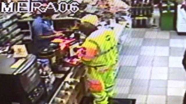 Surveillance video from an Exxon station convenience store in Upper Marlboro shows a man possibly celebrating Powerball win after checking his numbers.