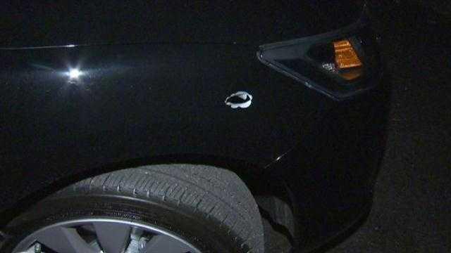 STRAY BULLET HITS CAR