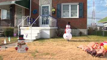 Someone seen on surveillance video calmly got out of a car, entered Smith's property and stole the arms off of a plastic Frosty the Snowman lawn decoration.
