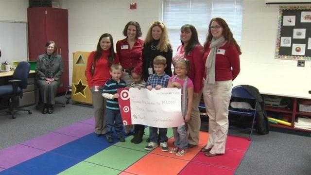 Target presents school with check