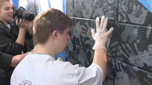 Perry Hall students decorate with mural of love