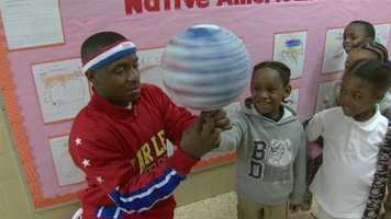 Jonte Hall, stands 5 feet 2 inches tall and plays for the Harlem Globetrotters who will be on the court on Saturday at the 1st Mariner Arena.