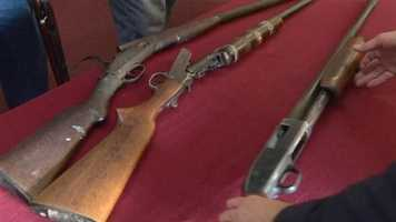 Baltimore City officials collect hundreds of firearms at an event aimed at trying to curb gun use in the area.