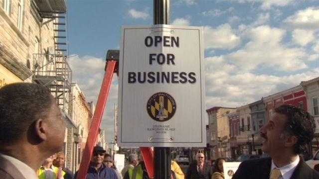 East Monument Street reopens for business