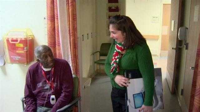 Volunteers deliver holiday cheer and gifts to veterans in the hospital.