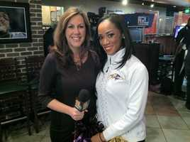 WBAL-TV 11 News reporter Jennifer Franciotti covers one of the stops along the Purple Caravan on Friday.