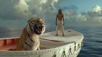"Life of Pi: ""Life of Pi"" is just as much an experience as it is a film. In a way, the film is both a spiritual contemplation as well as a buddy tale. The film follows the relationship between a tiger and a boy who are lost at sea. What it lacks in dialogue it makes up in visual splendor. Ang Lee's direction, the performance from newcomer Suraj Sharma, and the poetic imagery make this one of the best films of the year. Who thought a movie starring a CGI tiger would leave you examining your own life? -- Connor Smith"