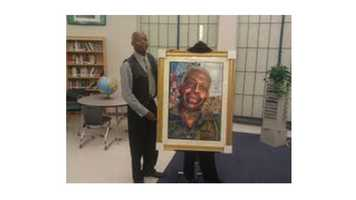 Brandon Lee said his high school art teacher, Mr. Chenal Alford (pictured here), gave him opportunities and believed in him. Lee also contributed to the painting Alford is standing next to.