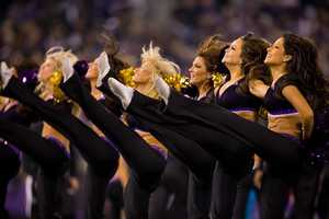 Ravens cheerleaders support the team, entertain fans at home games and serve as community ambassadors.