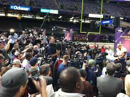 Superstar linebacker Ray Lewis draws a huge crowd during Media Day questioning.