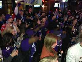 Crowds cheer on the Ravens at Mother's in Federal Hill.