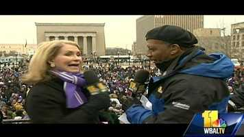 11 News anchors Donna Hamilton and Stan Stovall preside high over City Hall, where the parade is to kick off