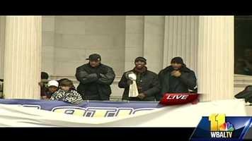 Terrell Suggs, Anquan Boldin and Ray Lewis watch the fans at City Hall.