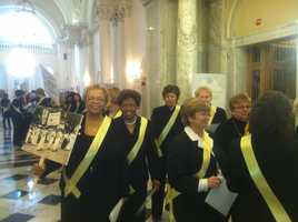 The ladies marched through the State House chambers to applause from their male counterparts.