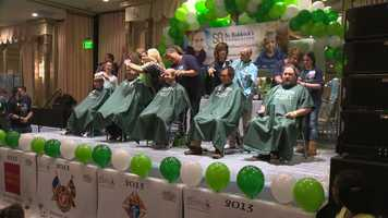 More than 170 people shaved their heads Sunday in solidarity for children who lost their hair after undergoing treatment for cancer.