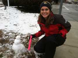 Ava Marie tries to make a (rather pitiful) snowman with the small amount of snow that fell in Baltimore City by 8 a.m.