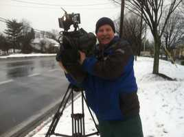 11 News photographer Tom Culp gets ready for Barry's liveshot.