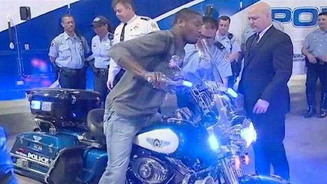 Wide receiver Jacoby Jones tries out the new bikes the Ravens gave as a thank you gift to the New Orleans Police Department.