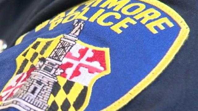 Baltimore City police badge on shoulder