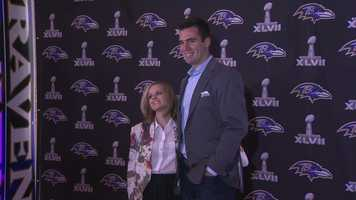 Flacco poses with his wife.