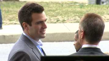 Flacco talks with 11 Sports director Gerry Sandusky.