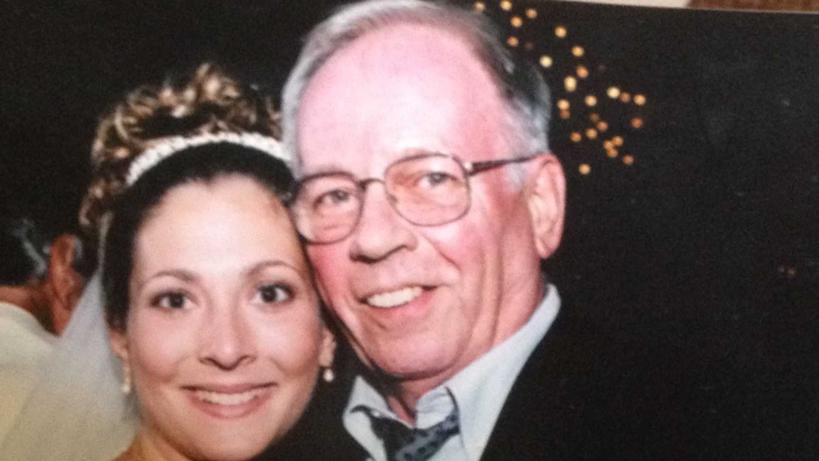 David Mack, seen here with his goddaughter a few years ago at her wedding.