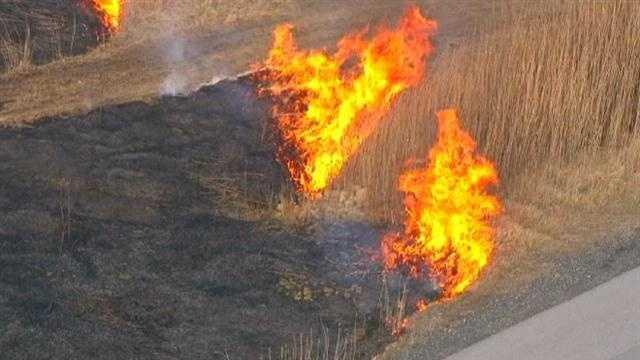 Brush fire burning in south Baltimore