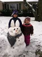 Brianna and Madison Maybury, of Denton, create an Easter snow bunny.