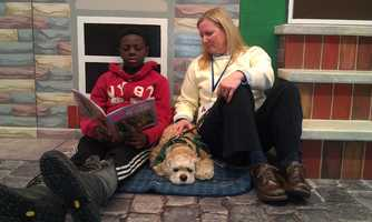 A boy named Wyleek, a fourth-grader who is on short-term placement at the Children's Guild, reads to Gabby in a hallway of the school. Read the story.